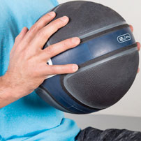 Man holding a medicine ball representing the physical therapy and pain management services at Premier Injury & Health Center in Columbus, OH