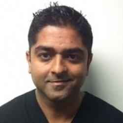 Dr. Ajay Syam, a licensed chiropractor who works at pain management provider Premier Injury & Health Center in Columbus, OH
